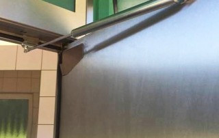 Back check on motorway toilet door