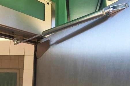 Back check on motorway restroom door