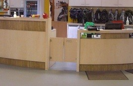 Swing door hinges for counter flaps in rock climbing centre