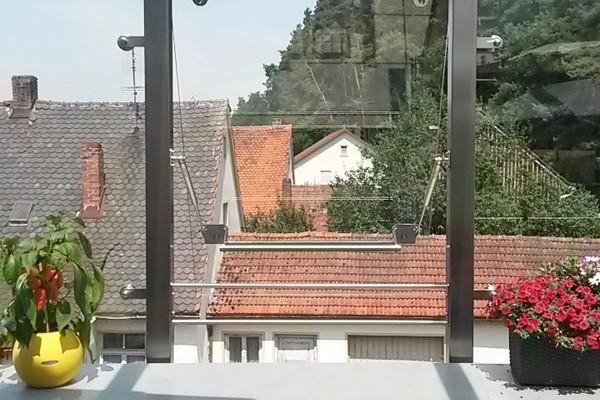 Gas springs open windows on roof terrace