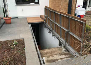 Cellar exit cover with gas springs
