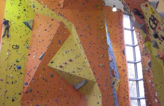Climbing center with integrated door on rock wall