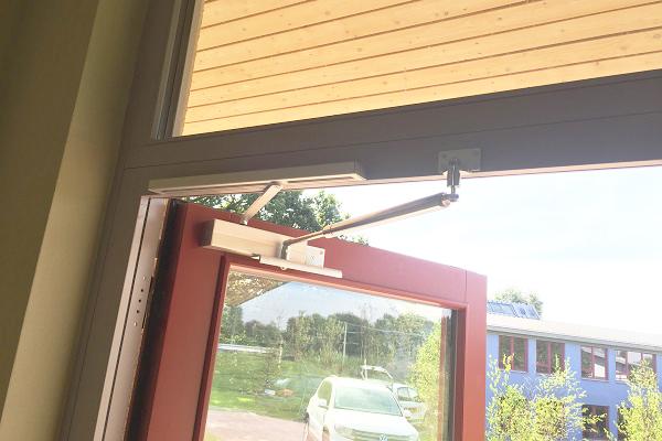 Back check together with door closer in school door