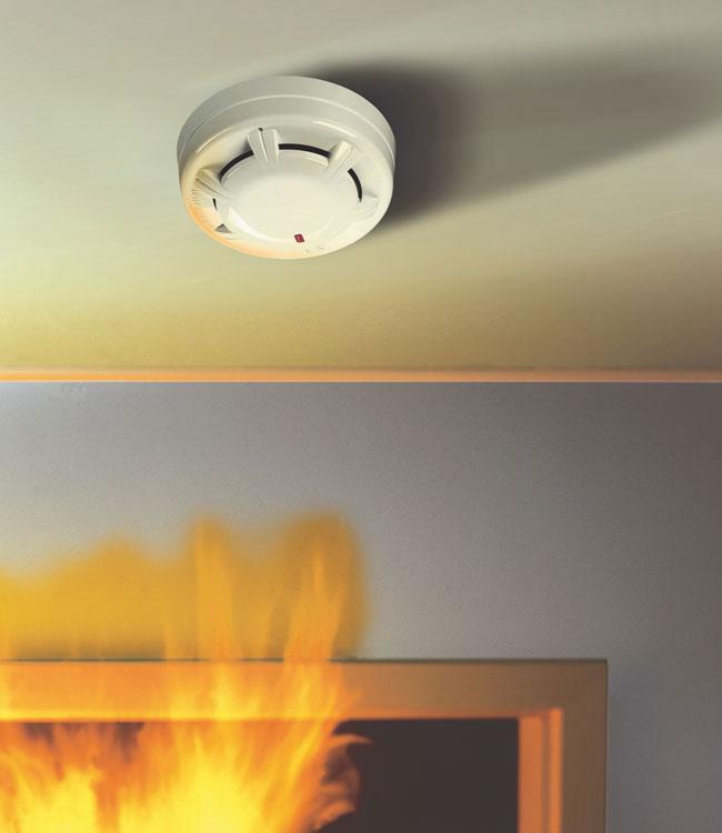 Smoke detector hold-open system fire doors heat detectors